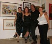 Diana Koch with friends in front of her work