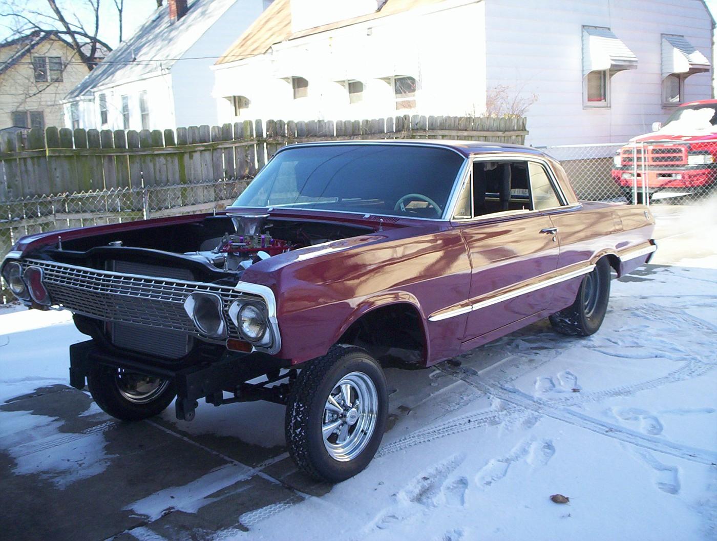 ... 02 chevy impala on 24 s w custom paint and suicide lambo doors