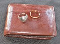 Jack's wallet and rings. Note scuff on top of wallet from the wreck . Wedding band has nicks . Class ring was returned smaller as it was repaired prior to giving back to Ruth.