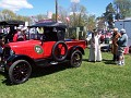 1929 Ford Pickup in red, with owners wearing period dress
