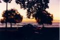 Lake Michigan sunrise over a 1991 Caprice