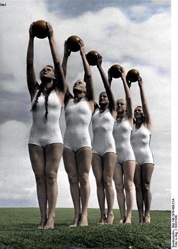 BDM girls practicing their gymnastics using a heavy leather ball