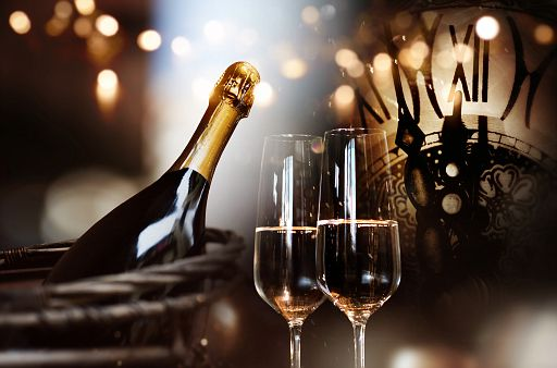 Congratulations for new year with champagne and clock