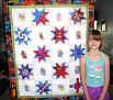 Alysia with her quilt