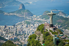 An aerial view of the christ redeemer statue overlooking the city of Rio de Janeiro, Brasil.