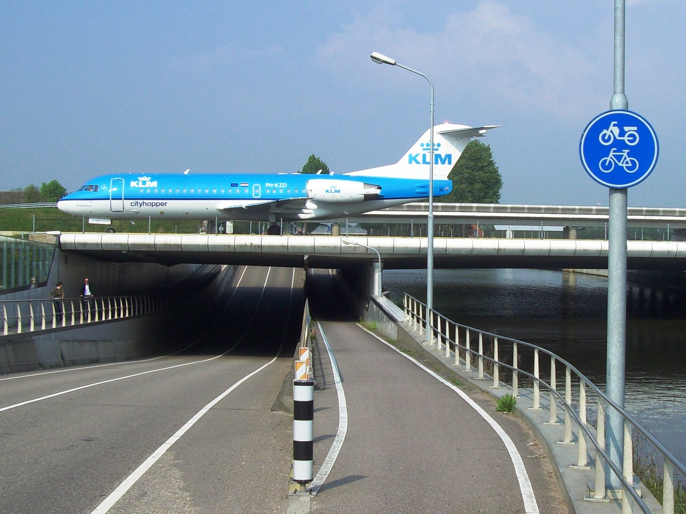 Airplane crosses cycle track