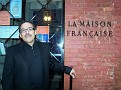 "Edouard Duval Carrie posing in front of ""La Maison Francaise"""